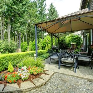 A Beginner's Guide To Building An Eco-friendly Outdoor Space: Gazebo next to a house