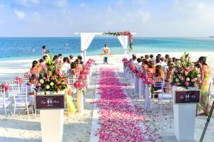 Beach wedding ceremony during the daytime